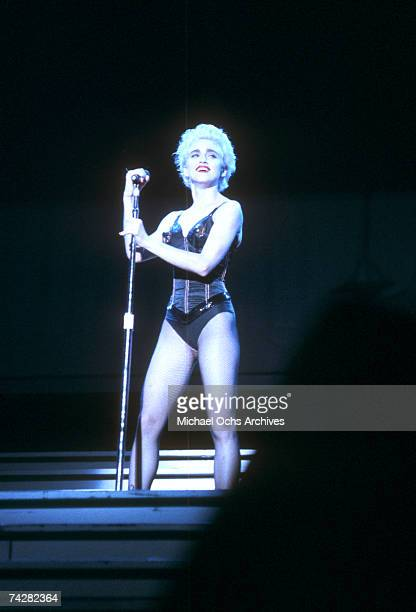 Pop singer Madonna performs onstage in a black bustier with lingerie on on August 6 1987 in Los Angeles California