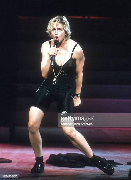 Pop singer Madonna performs onstage in spandex and a bustier with back up dancers in September 1989 in Los Angeles California