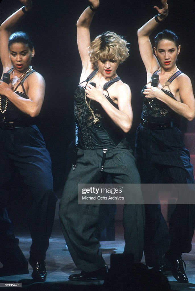Pop singer Madonna performs onstage in spandex and a bustier with back up dancers in September 1989 in Los Angeles, California.