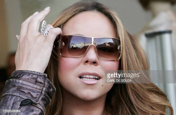 US pop singer Mariah Carey arrives at the Pinko Boutique Clothing Store in London 15 February 2007 Carey was announced Thursday as the new face of...