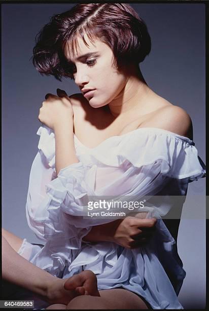 Pop Singer Martika Wearing a sheer Ruffled Blouse