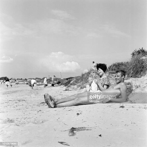 Pop singer Marty Wilde and his 19yearold wife Joyce on the beach at Shell Bay Dorset They are living in Sandbanks while Marty is appearing at the...