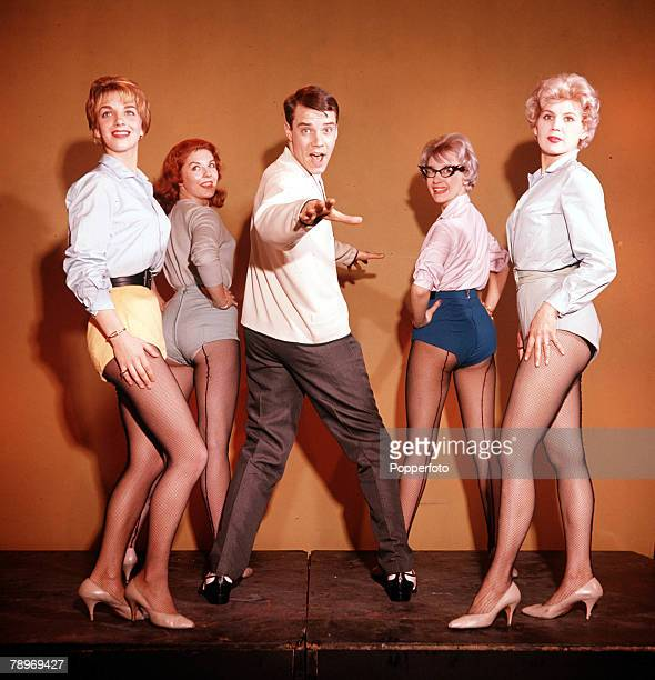 Pop Singer Marty Wilde performing his routine with four female dancers 1960