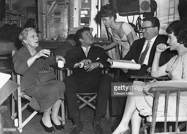 Pop singer Marty Wilde with Dame Sybil Thorndike Jackie Lane Harry Secombe and Diane Cilento at Shepperton Studios during a break in the filming of...