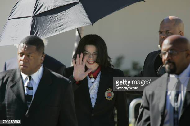 Pop singer Michael Jackson exits the Santa Barbara County courts surrounded by his bodyguards on the second day of jury selection in Jackson's trial...