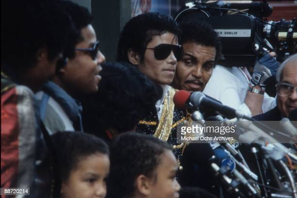 Pop singer Michael Jackson flanked by his father Joe Jackson receives a star on the Hollywood Walk Of Fame in 1984 in Los Angeles California