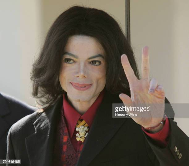 Pop singer Michael Jackson gestures to fans after leaving the Santa Barbara County Courthouse Superior Court Judge Rodney S Melville announced that a...