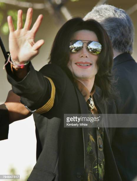Pop singer Michael Jackson gestures to fans as he enters the Santa Barbara County Courthouse Yesterday eight women and four men were selected to...