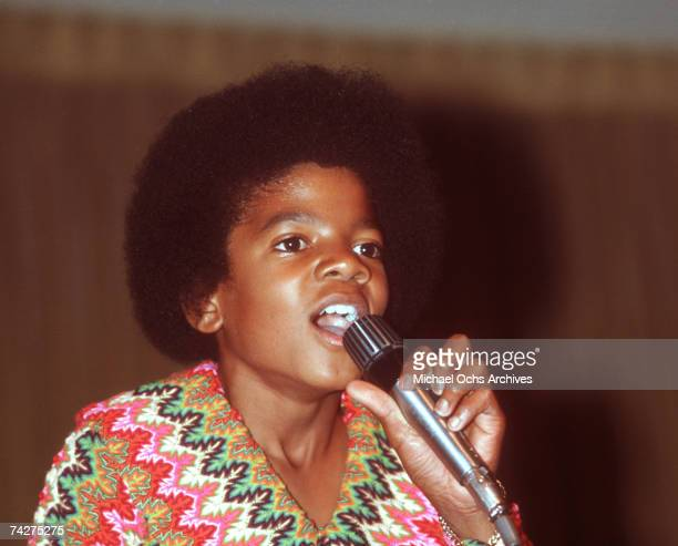 Pop singer Michael Jackson of the RB quintet 'Jackson 5' performs onstage wearing a bright patterned shirt at a concert for the Foundation for the...