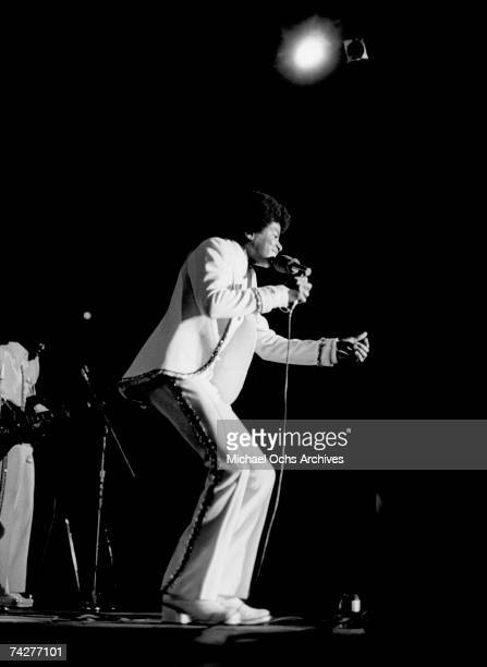 Pop singer Michael Jackson of the RB quintet Jackson 5 performs onstage wearing a white suit in circa 1972