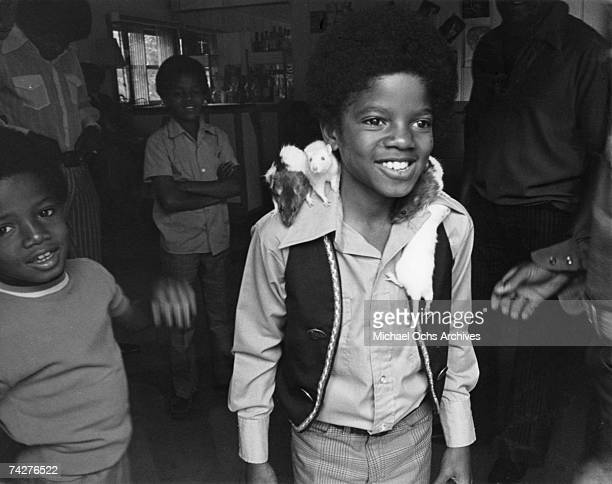 Pop singer Michael Jackson of the RB quintet The Jackson 5 attends a party with his brothers Randy Jackson Jackie Jackson and Marlon Jackson to...