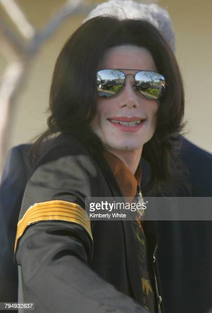 Pop singer Michael Jackson smiles as he enters the Santa Barbara County Courthouse Yesterday eight women and four men were selected to serve as the...