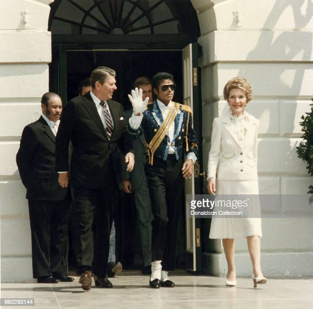 Pop singer Michael Jackson visits President Ronald Reagan and his wife Nancy Reagan at the White House on May 14 1984