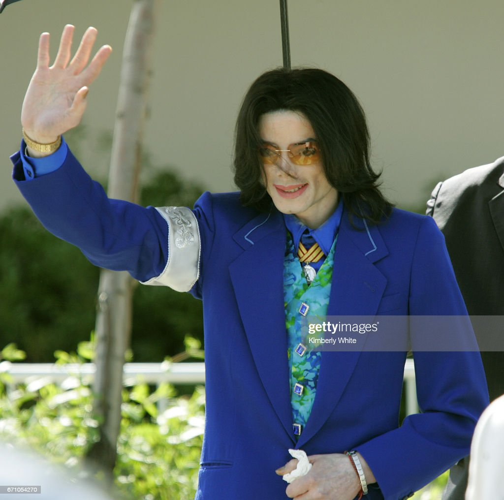 Pop singer Michael Jackson waves to his fans and media as he leaves the Santa Barbara County Court in Santa Maria during the third week of his child molestation trial.