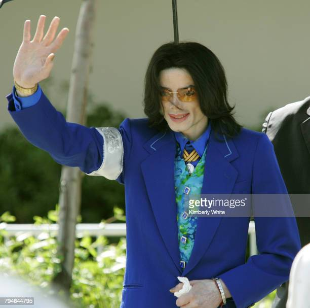 Pop singer Michael Jackson waves to his fans and media as he leaves the Santa Barbara County Court in Santa Maria during the third week of his child...