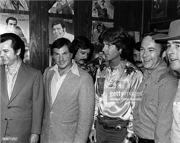 Pop singer Rick Nelson poses for a portrait with Conway Twitty and others in circa 1973