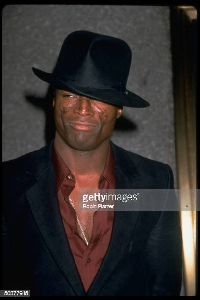 Pop singer Seal wearing black fedora