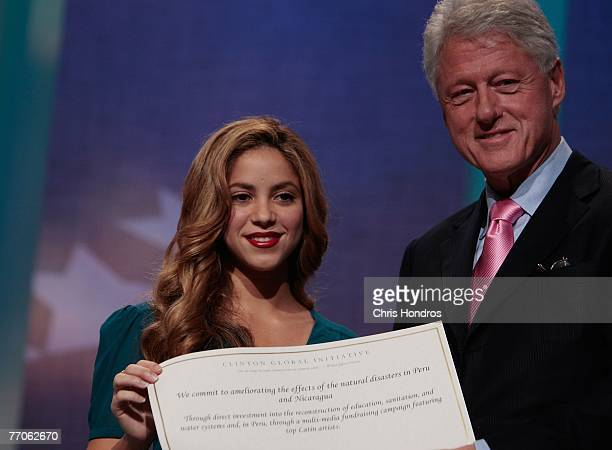 Pop singer Shakira appears with former US President Bill Clinton after pledging her support to natural disaster recovery efforts in Latin America...