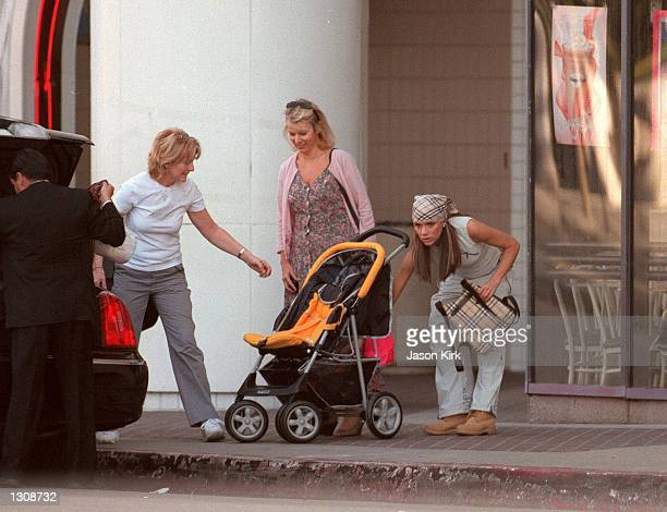 Pop Singer Victoria Adams 'Posh Spice' along with her mother Jackie Adams get help loading the limo with there packages October 12 2000 in Los...