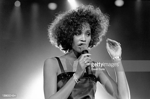 Pop singer Whitney Houston performs onstage in 1988