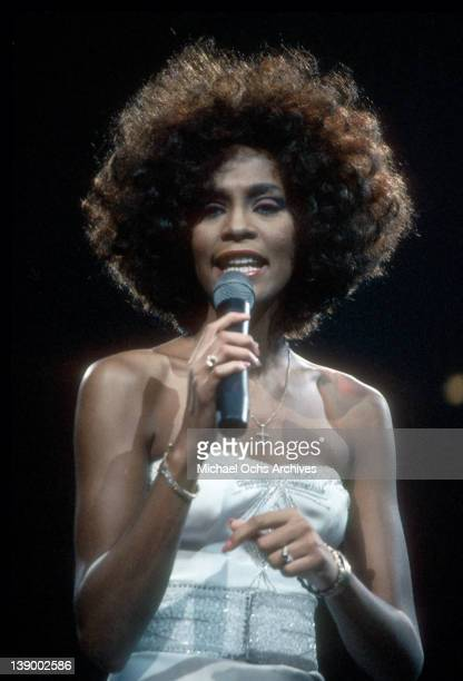 Pop singer Whitney Houston performs onstage in circa 1987