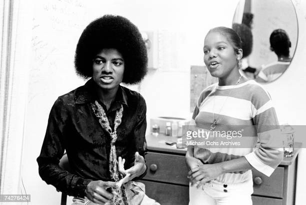 Pop singers and siblings Janet Jackson and Michael Jackson take a break during a portrait session on July 7, 1978 in Los Angeles, California.