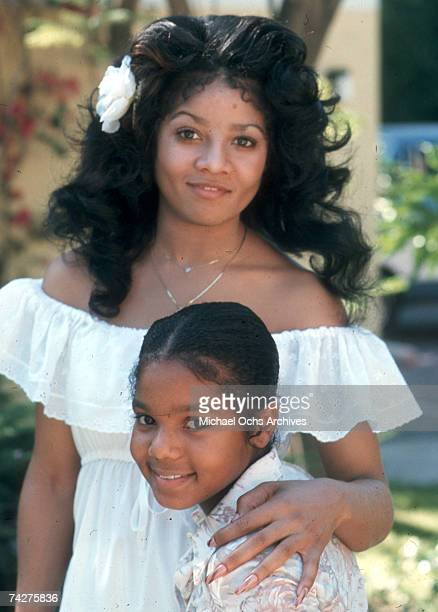 Pop singers and sisters Janet Jackson and LaToya Jackson pose for a portrait session in January 1977 in Los Angeles California