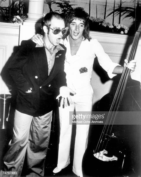 Pop singers Rod Stewart and Elton John pal around at an event in circa 1976
