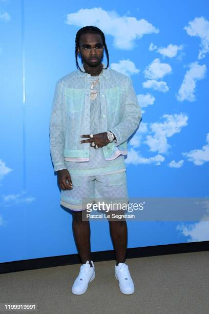 Pop Smoke attends the Louis Vuitton Menswear Fall/Winter 20202021 show as part of Paris Fashion Week on January 16 2020 in Paris France