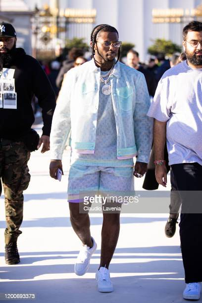 Pop Smoke wearing a Louis Vuitton white top with matching jacket and shorts is seen outside the Louis Vuitton show during the Paris Fashion Week...