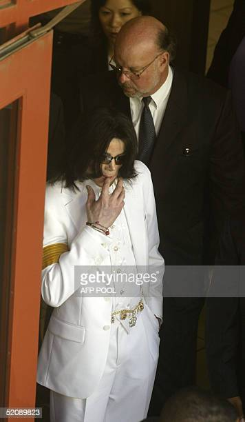 US pop sta Michael Jackson prepares to exit the Santa Barbara County Courthouse for a lunch break during jury selection for his child molestation...