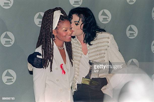 US pop star and entertainer Michael Jackson kisses his sister Janet Jackson after she presented him with the Grammy Legend Award at the 35th Annual...