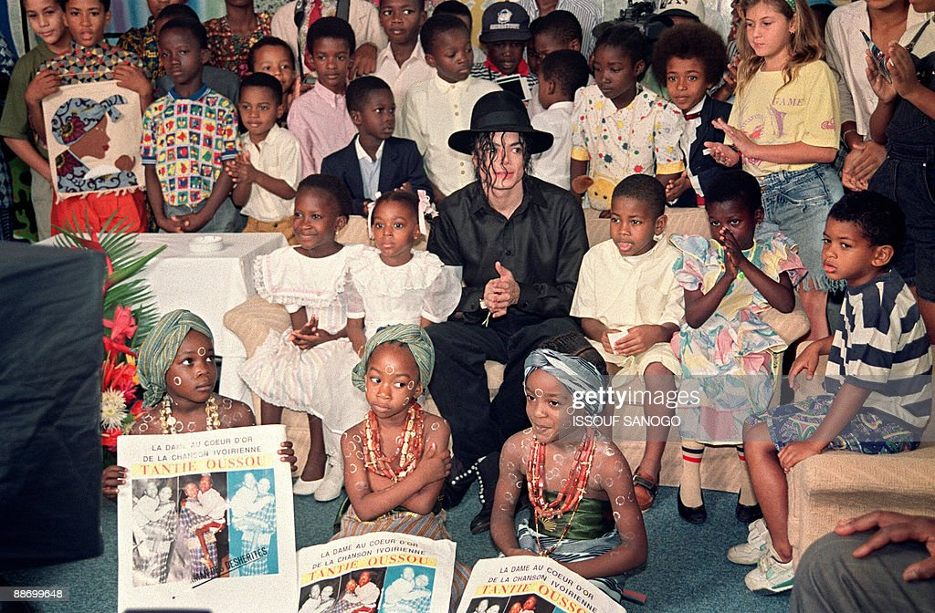 b2bfe1233c7a4 US pop star and entertainer Michael Jackson sits with orphaned and ...