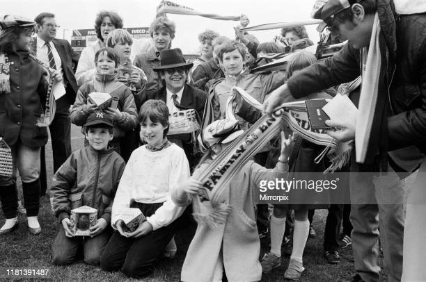 Pop star and Watford FC Chairman, Elton John, handing out Easter eggs to fans. Watford v Southampton football match. 6th April 1985.