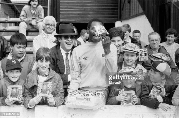 Pop star and Watford FC Chairman, Elton John, handing out Easter eggs to fans. Watford v Southampton football match, 6th April 1985.