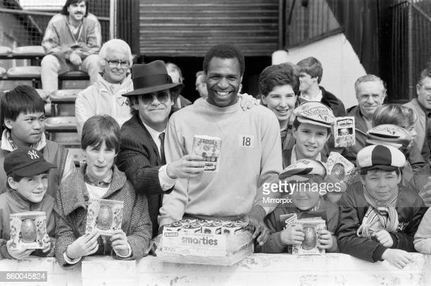 Pop star and Watford FC Chairman Elton John handing out Easter eggs to fans Watford v Southampton football match 6th April 1985