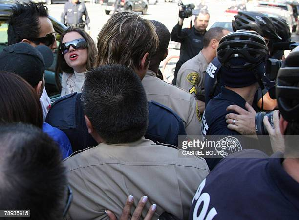 Pop star Britney Spears arrives with her boy friend Adnan Ghalib at the Los Angeles County Superior courthouse 14 January 2008for a hearing regarding...