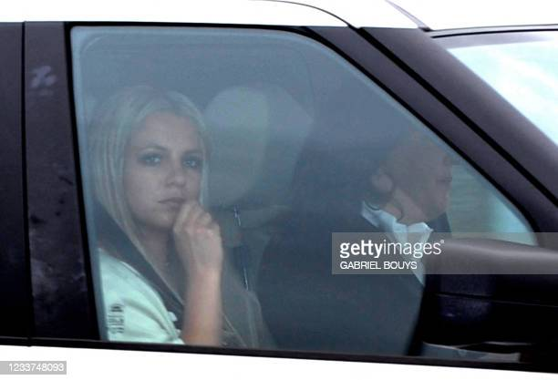 Pop star Britney Spears leaves the Los Angeles County Superior courthouse after a child custody status hearing on May 6, 2008. Spears has been locked...