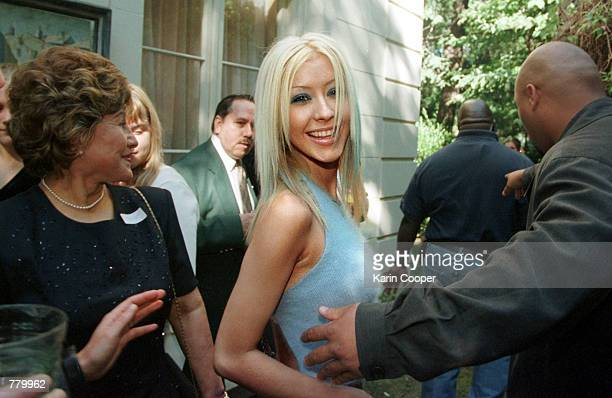 Pop star Christina Aguilera arrives at a side entrance to the Ecuadorian Embassy Residence September 17 2000 in Washington DC where she sang and...