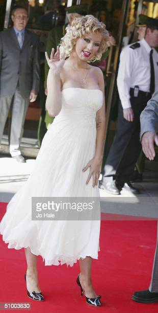 Pop star Christina Aguilera officially opens the Harrods Summer sale on June 28, 2004 at the Knightsbridge store, in London.