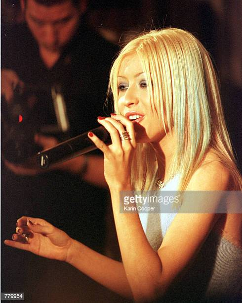 Pop star Christina Aguilera performs at the Ecuadorian Embassy Residence September 17 2000 in Washington DC where she sang and signed autographs at a...