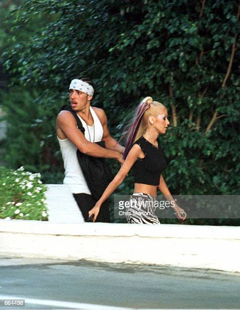 Pop star Christina Aguilera walks down a parking ramp with her new boyfriend Jorge Santos a 24 year old backing dancer October 1 2000 in Los Angeles...