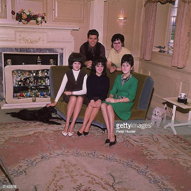 Pop star Cliff Richard at home with his mother and sisters