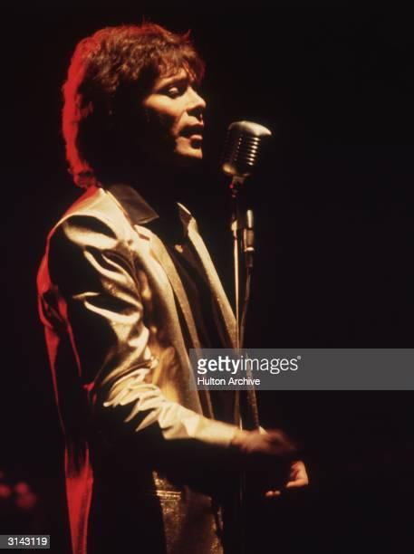 Pop star Cliff Richard singing at the Apollo Theatre London