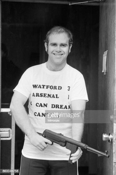Pop star Elton John, also Chairman of Watford FC, pictured in Los Angeles giving his version of the top quarter final of the FA Cup - Watford v...