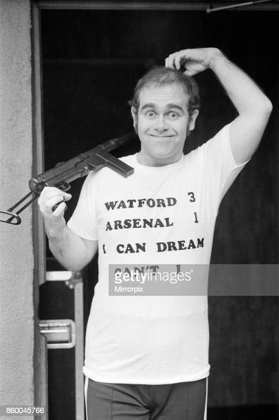 Pop star Elton John also Chairman of Watford FC pictured in Los Angeles giving his version of the top quarter final of the FA Cup Watford v Arsenal...