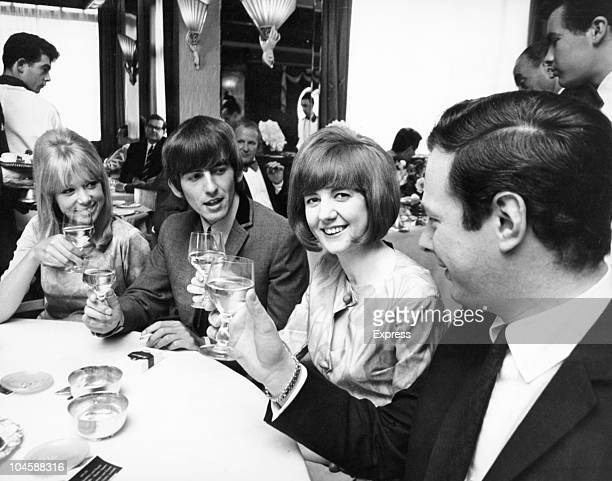 Pop star George Harrison of The Beatles Beatle manager Brian Epstein singer Cilla Black and her friend Patti Boyd on May 28 1964