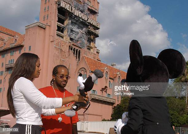 Pop star Janet Jackson and rapper/producer Jermaine Dupri took time out from their theme park fun to meet Mickey Mouse at Walt Disney World Resort on...