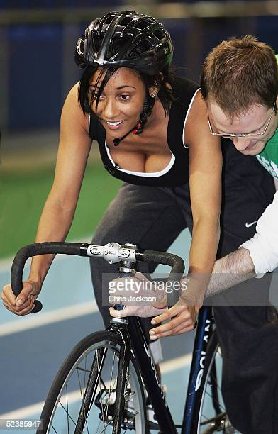 Pop star Lisa Maffia is assisted during a cycling training session ahead of the new series of the reality TV show The Games, at the English Institute...