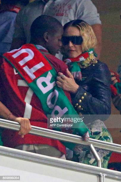 US pop star Madonna and her son David Banda attend during the FIFA World Cup 2018 Group B qualifier football match between Portugal and Switzerland...